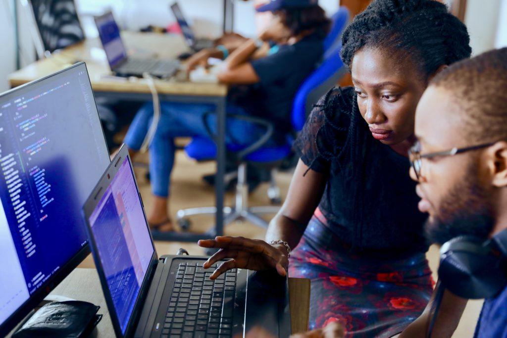 women looking at computer